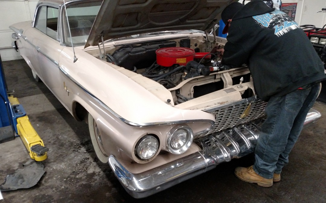 1961 Plymouth Fury and the loose clamp.